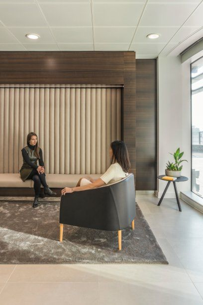 Workspace and Office Design Projects in Amsterdam: StepStone | Unispace. Reception. High end. Banquette seating. Dark wood veneer