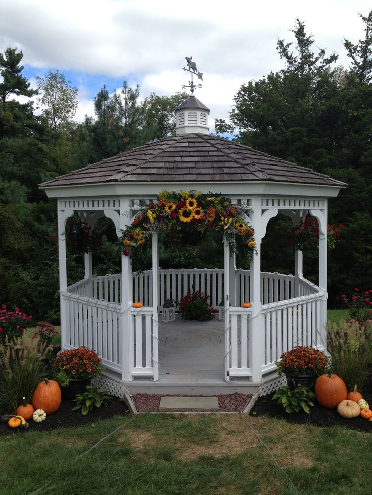 Decorated Gazebo for a Fall Wedding.  Wedding, Flowers, Pumpkins, Ceremony, Gazebo.  Check out Waters Edge for your dream outdoor wedding!  http://www.watersedgevineyard.com/INdex.html https://www.facebook.com/watersedgevineyard
