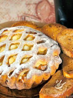 La Crostata di grano saraceno alla crema è una squisitezza che farà felici gli amanti delle crostate ricoperte e ripiene di farce morbide e golose!