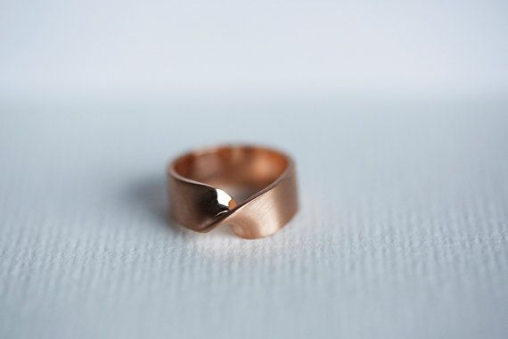 Wide rose gold ring with a twist on front, perfect for everyday wear.  The ring online has satin (matte) finish, but it can also be polished or brushed. The ring is polished in high shine inside. If you decide to purchase the ring, please add a note regarding the finish: polished, satin or brushed. Band measurements: 8 mm