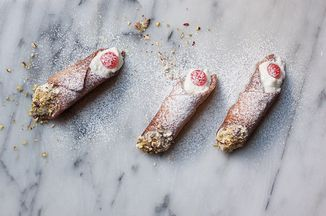 """You will need cannoli tubes—small metallic tubes for rolling the dough around (something like <a href=""""http://www.amazon.com/Norpro-3660-Stainless-Steel-Cannoli/dp/B000LBU1VQ?tag=food52-20"""">these</a href>)—to make this recipe.  I was inspired to try making these after tasting the crisp, ricotta-filled cannoli, dipped on both sides in chopped pistachios, at Caffe dell'Arte in the beautiful baroque town of Modica. I adapted a recipe I found in a Sicilan cookbook by Eleonora Consoli called La…"""