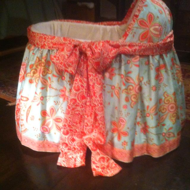 My mother in law took an old wicker bassinet and transformed it with this precious fabric! Oh how I want a baby girl!