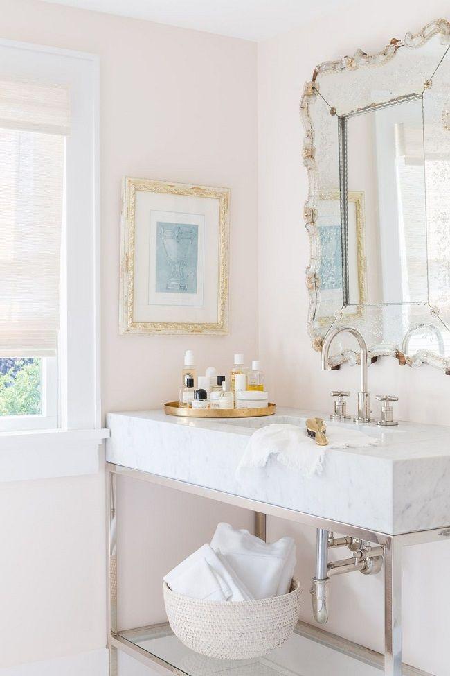 Interior designer Raquel Garcia's Cape Cod home with a chic, beach cottage flair | Bathroom is light, airy and feminine!