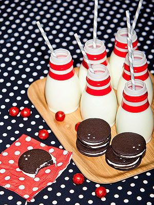 For an alley-appropriate snack, wrap strips of 1/2-inch red electrical tape around the neck of single- serving milk bottles. The bowling ball cookies come together quickly with chocolate wafers and white frosting.