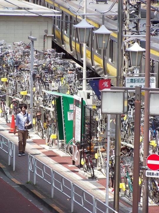 Japan lotsa people,lotsa bikes,lotsa people on bikes.