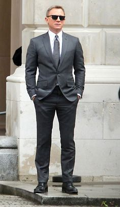 Daniel Craig spotted wearing grey pinstripe suit in #London during shooting SPECTRE