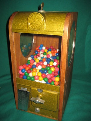 Antique Victor gumball machine, wood and glass.