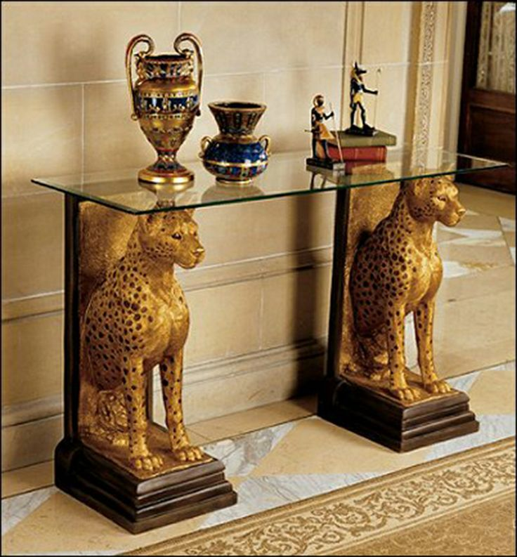Egyptian Interior Style with the animals as stands and golden, even the vases have Egyptian style and colors in them.