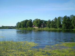 Aluksne castle ruins seen over the lake