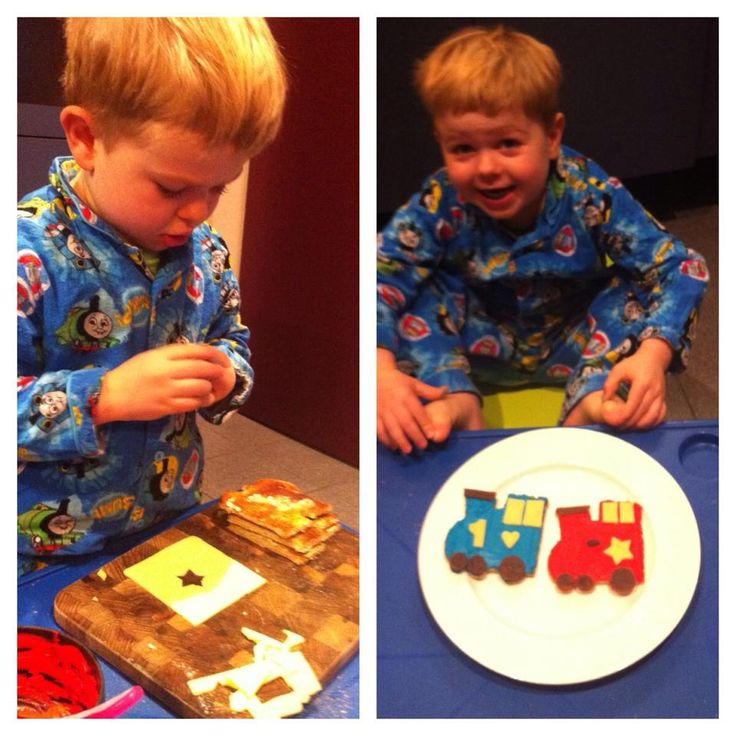 Toast trains - made with a train 'cookie cutter' (from Target, but you could easily cut out your own basic shape). Red and blue colours created with cream cheese and food dye with a bit of honey mixed in. Details cut out of cheese and fruit leather with cookie cutter shapes.