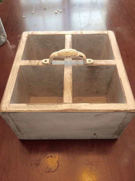 This centerpiece/utility box measures 11x11x6.25 and is perfect for  utensils, centerpieces