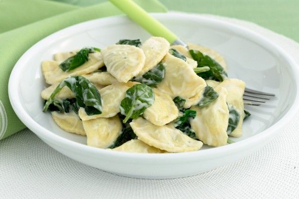 Spinach and ricotta agnolotti with creamy cheese sauce main image