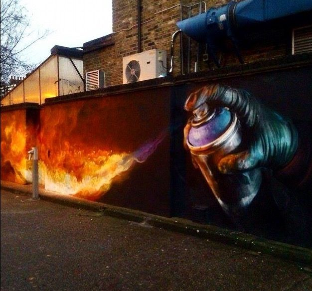 Street Art, fiery spray can painting by Irony in Camden, London, 12/14 (LP). Please also visit www.JustForYouPropheticArt.com for more colorful art you might like to pin. Thanks for looking!