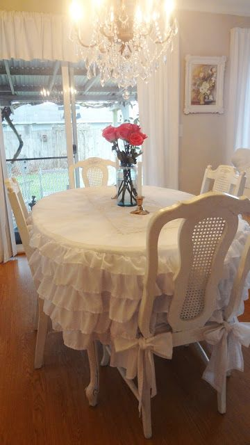 How to Sew a Ruffled Tablecloth - using a dust ruffle. This is a clever way to make the size tablecloth you need at a fraction of the time it would take if you were to machine stitch it - For the Love of White: Making a Ruffled Bedskirt Tablecloth