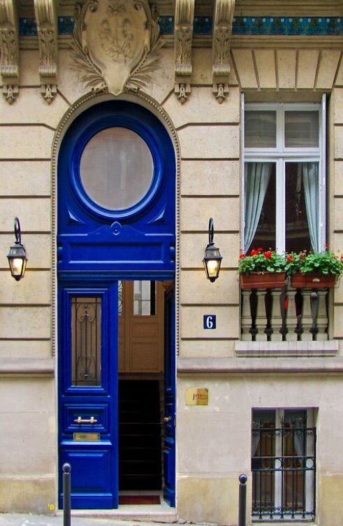 Love this jewel blue door and the ornaments around and above the door. Pretty tile up there. And that round window, would be fun to see inside. Click on the link for a grander picture .. and more! Paris, France