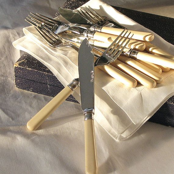 Vintage faux bone handled Fish Knives and Forks, six pairs, with original box. English. 1920's-1930's www.siver-and-grey.com