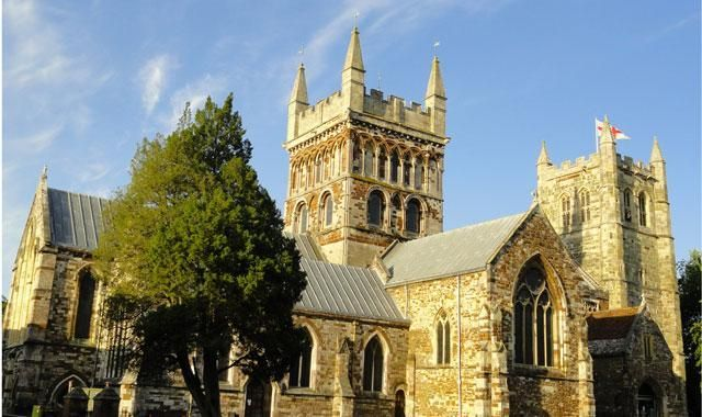Wimborne Minster.dates mainly from the Norman period but was  greatly upgraded in Victorian times with new stained glass and floor  tiles. It started life as a nunnery destroyed by the Danes in 1060 It was the refounded with secular canons by the Normans