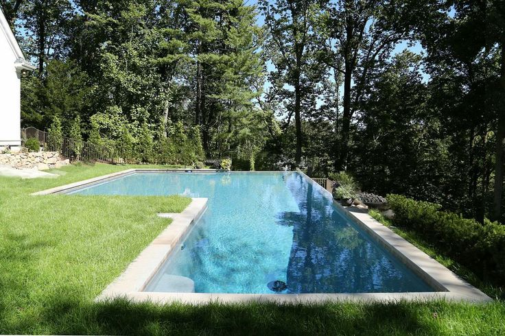Bent L Shaped Swimming Pool With A French Grey Aquabright