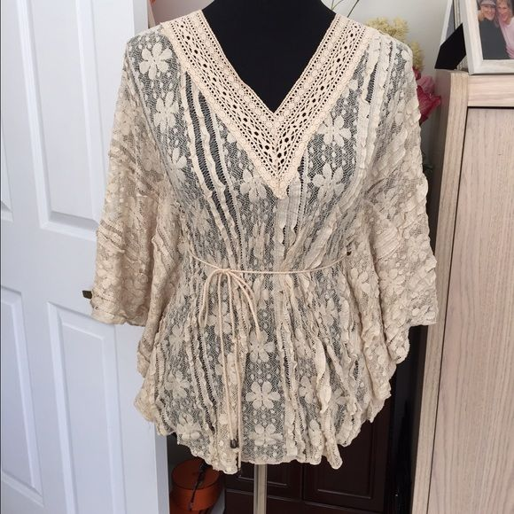 HP..NWOT...Solitaire cream colored lace top... Company....Solitaire .... Cream colored lace top, has a draw string through the middle, can be worn in the front or back, or not at all. See photos. Hand washable. Excellent condition, No trade, no pp, smoke and pet free environment Solitaire Tops Blouses