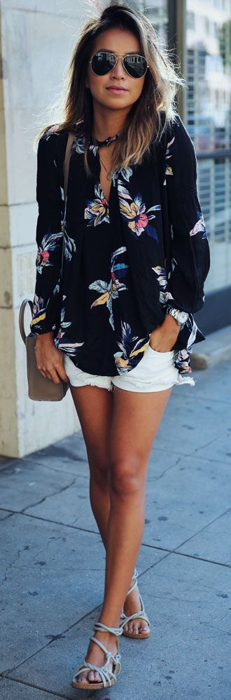 Shop this look on Lookastic: https://lookastic.co.uk/women/looks/button-down-blouse-shorts-flat-sandals/20211   — Black Sunglasses  — Black Floral Button Down Blouse  — Silver Watch  — Brown Leather Crossbody Bag  — White Denim Shorts  — Grey Leather Flat Sandals
