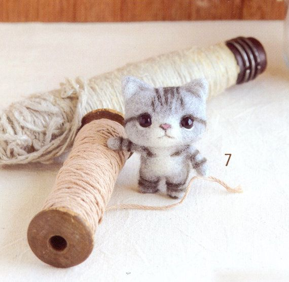 Super cute needle felted kitten.