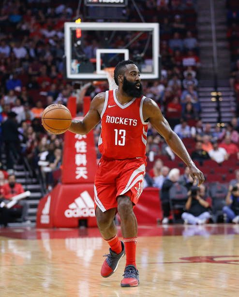 James Harden of the Houston Rockets brings the ball up the court against the Toronto Raptors at Toyota Center on November 14 2017 in Houston Texas...