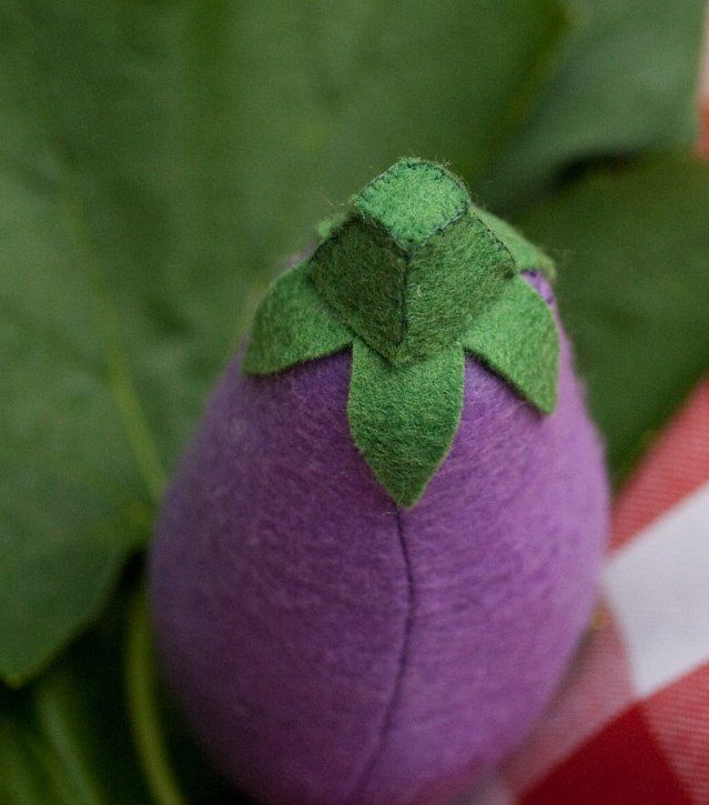 Handsewn felt leaves on top of eggplant