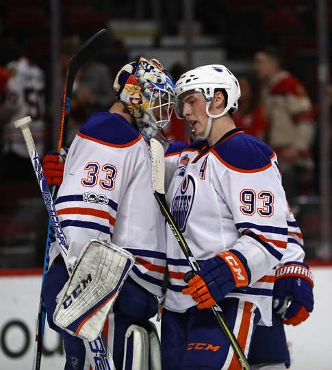 CHICAGO, IL - FEBRUARY 18: Ryan Nugent-Hopkins #93 of the Edmonton Oilers taps helmets with Cam Talbot #33 after a win over the Chicago Blackhawks at the United Center on February 18, 2017 in Chicago, Illinois. The Oilers defeated the Blackhawks 3-1. (Photo by Jonathan Daniel/Getty Images)