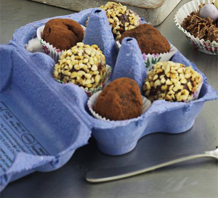 Chocolate truffle egg box. Pop rich chocolate sweets rolled in nuts and cocoa in an empty egg box for an extra-special finish.