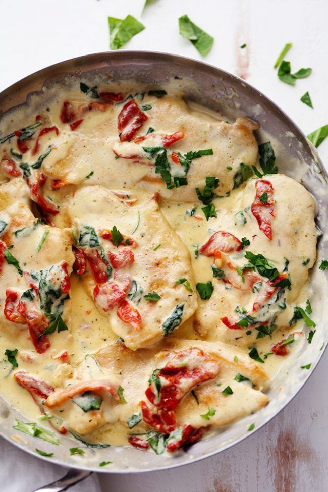 """""""Creamy Tuscan Garlic Chicken has the most amazing creamy garlic sauce with spinach and sun dried tomatoes. This meal is a restaurant quality meal ready in 30 minutes!"""""""