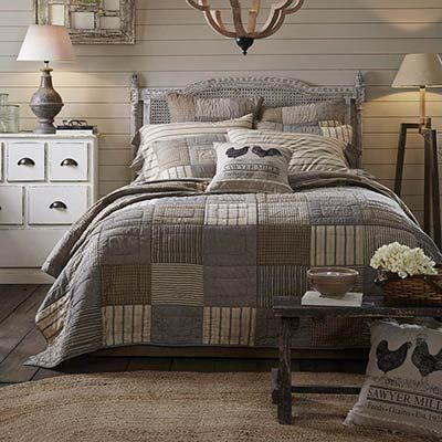 Relax in a farmhouse style bedroom with this simple block patchwork quilt, featuring plaid and striped fabrics in ash grey, black, and creme. This is for the King size quilt.