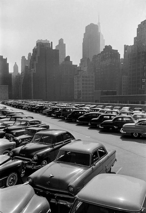 Werner Bischof - USA. New York city. Manhattan. Car parking lot. 1953.