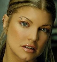 After seeing Fergie's eyebrow piercing.... I had to get one of my own .