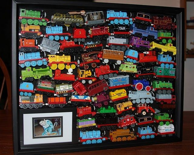 Shadow Box Memories - Trains, cars, trinkets. Add a photo of your child playing with the toys.
