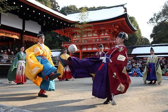"""Clad in traditional Japanese costumes, participants play """"Kemari,"""" an ancient Japanese ball-lifting game using only the right leg, at the Shimogamo shrine in Kyoto.     Jiji Press/Agence France-Presse/Getty Images"""