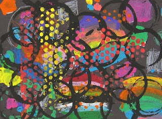 I like this idea - painting, gluing pieces of paper and printmaking circles of all kinds.