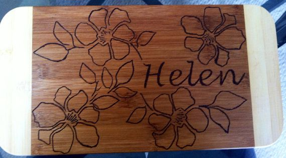 Hibiscus flower bamboo cutting board ...I've gotta try this...would make a great Christmas gift for all the ladies in our family!