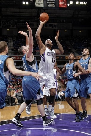 DeMarcus Cousins #15 of the Sacramento Kings shoots the ball against Kevin Love #42 of the Minnesota Timberwolves on November 27, 2012 in Sacramento