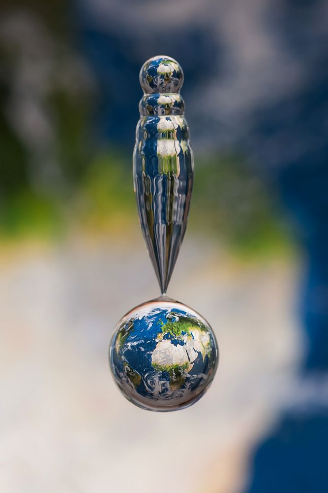 Photographer Markus Reugel recently captured this incredibly sharp photo of Earth in a water drop using his trademark set-up. Called Falling Earth, it's the latest in his ongoing series titled Refractions.  There is a map in the background