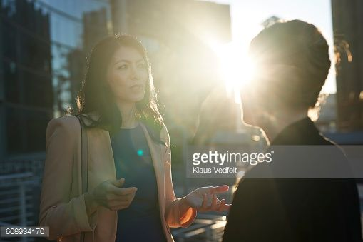 Stock Photo : Group of businesspeople having discussions outside
