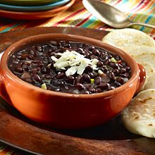 In Venezuela, black beans, called Caraotas Negras, can be found simmering on the stove in kitchens throughout the country. Venezuelan Black Beans are an important component of the national dish, Pabellon Criollo, served with white rice and shredded beef.