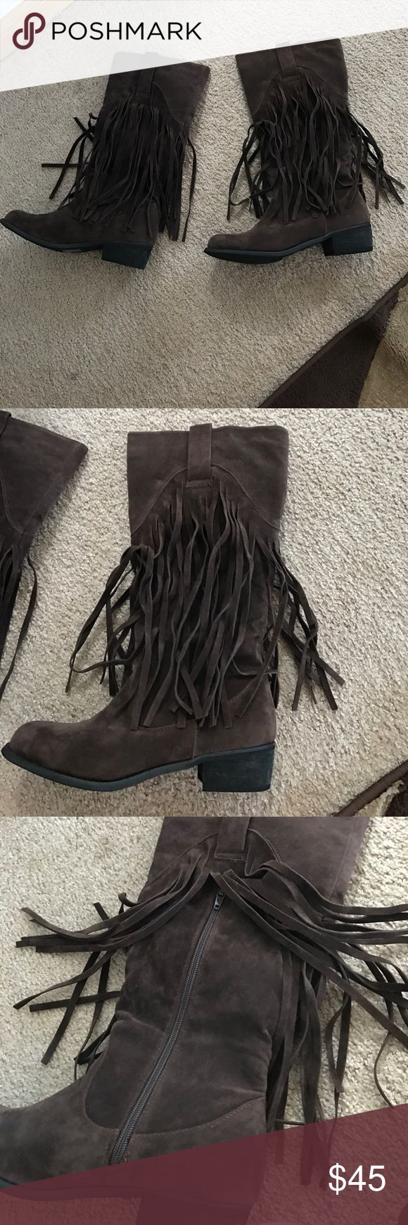 Cute faux suede fringe boots These boots are a re-posh... bought them and they turned out to be too snug ... they say they are a size ten but I believe they run a little small ... would maybe fit a 9.5 better or a narrow ten ... definitely not for wide feet at all .. have zippers on the sides for easy wear and are so so cute !!! Amazing with jeans or leggings and a sweater ! My loss your gain ! Brand new with the box ! Never worn ! Are not over the knee but close to the knee ! Shoes Over the…