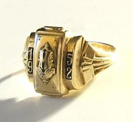 """Class rings were used to """"go steady"""" - girls often used tape or yarn to make them fit or else wore them on a chain around their neck.  Still have my husband's ring, that he had made smaller for me, over 58 years ago."""