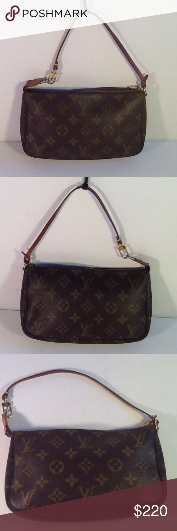 Authentic Louis Vuitton Monogram Pochette Hanbag. The canvas and inside linen are good. The strap showed signs of used . The bag was made in France with a date code AR 1020.  The dimension us 5, 8 and 1. Louis Vuitton Bags Clutches & Wristlets