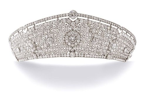 The Pole-Carew tiara, kokoshnik shape by Cartier. Articulated openwork design of millegrain quadrilobe motifs, set throughout with cushion-shaped diamonds, mounted in platinum, ca. 1922
