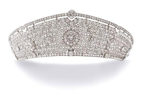 The Pole-Carew tiara, kokoshnik shape by Cartier. Articulated openwork design of millegrain quadrilobe motifs, set throughout with cushion-shaped diamonds, mounted in platinum, ca. 1922