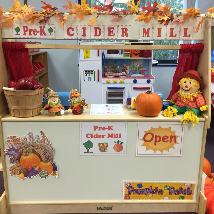 Dramatic Play Area Fall Theme: Pre-K Cider Mill. Fill with pretend apples, pumpkins, cider jugs, donuts, leaves, vegetable market, and fall decor! The kids love it!
