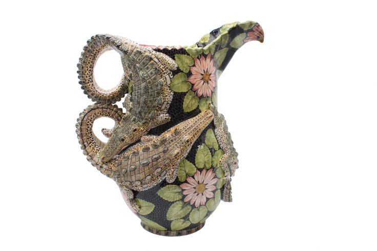 A sensual, sensational Crocodile Jug sculpted by Somandla Ntshalintshali and painted by Zinhle Nene.