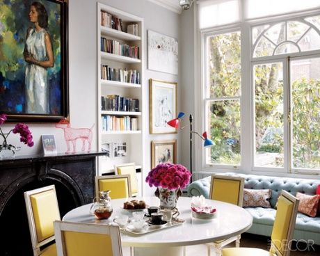 Love the yellow-backed chairs with white table. And the built-in bookcase, and the lovely white window!
