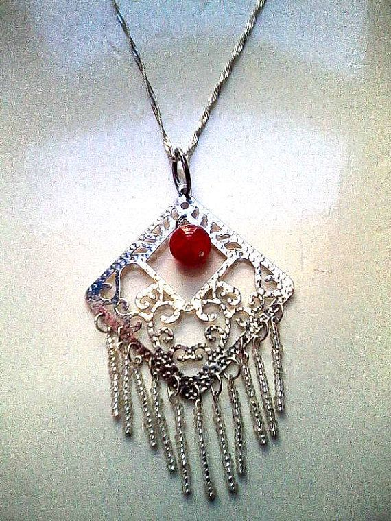 Check out this item in my Etsy shop https://www.etsy.com/listing/215823416/big-gypsy-pendant-necklace-silver-tone